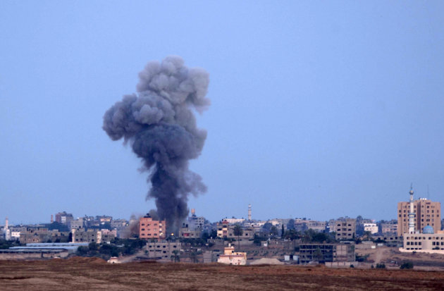 Smoke is seen after an Israeli strike in the northern Gaza Strip, Friday, Nov. 16, 2012. Early Friday, 85 missiles exploded within 45 minutes in Gaza City, sending black pillars of smoke towering abov