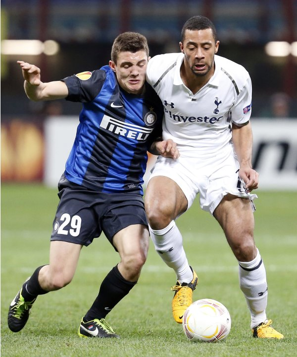Inter Milan's Kovacic fights for the ball with Tottenham Hotspur's Dembele during their Europa League soccer match in Milan
