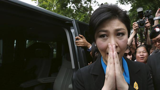 Ousted former Thai Prime Minister Yingluck Shinawatra leaves the Supreme Court in Bangkok