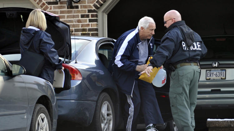 Former Penn State football coach Jerry Sandusky gets out of a car in front of his State College, Pa., home on Thursday, Dec. 8, 2011.  The former Penn State assistant football coach was released from jail Thursday after spending a night behind bars following a new round of child sex abuse charges filed against him.  Sandusky secured his release using $200,000 in real estate holdings and a $50,000 certified check provided by his wife, Dorothy, according to online court records.  (AP Photo/Centre Daily Times, Nabil K. Mark)  ALTOONA MIRROR OUT , MAGS OUT, NO SALES
