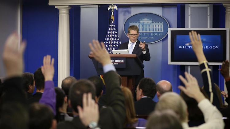 Reporters raise their hands as White House press secretary Jay Carney takes questions during his daily news briefing at the White House in Washington, Tuesday, May, 14, 2013. Carney touched on various topics including the Justice Department's secretly obtaining two months of telephone records of reporters and editors for The Associated Press and IRS. (AP Photo/Pablo Martinez Monsivais)