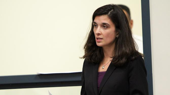 Melinda Thompson, attorney for Irish nanny Aisling McCarthy Brady, speaks during a hearing at Cambridge District Court in Medford, Mass., Friday, March 22, 2013. During the hearing, where Brady stood in a hallway and was not visible to the courtroom, the judge delayed her probable cause hearing. Thompson argued against the postponement and Brady's $500,000 bail. The judge didn't reduce bail and set the next proceeding for April 22.  (AP Photo/Irish Independent, Chitose Suzuki, Pool)