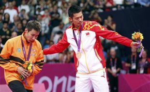 Gold medallist Lin Dan, right, and silver medallist Lee Chong Wei of Malaysia (Reuters)