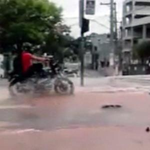 Motorcyclist in Brazil hits a pothole