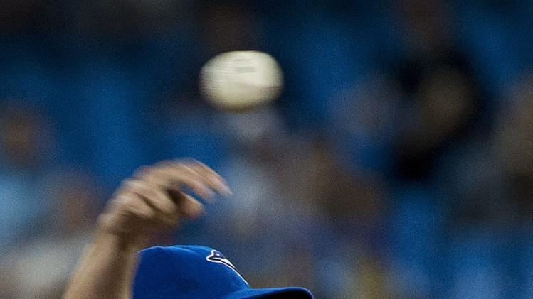 Toronto Blue Jays pitcher Aaron Sanchez makes his major league debut as he throws against the Boston Red Sox during seventh-inning baseball game action in Toronto, Wednesday, July 23, 2014. (AP Photo/The Canadian Press, Nathan Denette)