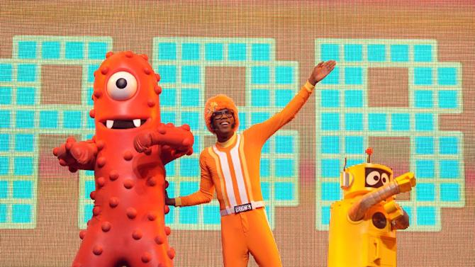 DJ Lance Rock, center, Muno and Plex perform onstage at Yo Gabba Gabba! Live!: Get The Sillies Out! 50+ city tour kick-off performance on Thanksgiving weekend at Nokia Theatre L.A. Live on Friday Nov. 23, 2012 in Los Angeles. (Photo by John Shearer/Invision for GabbaCaDabra, LLC./AP Images)