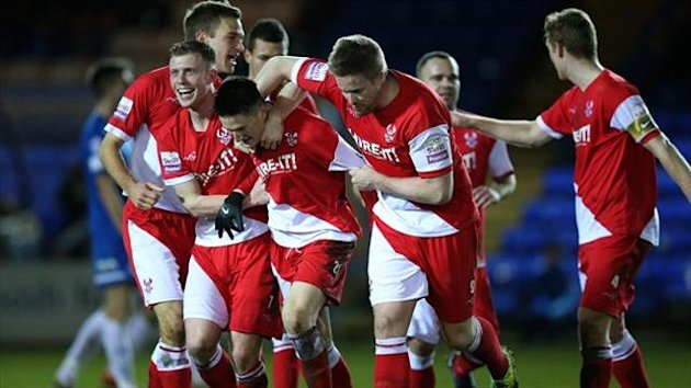 Kidderminster players celebrate with Joe Lolley, centre, after his winning goal