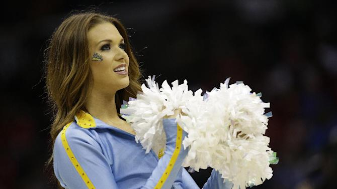 UCLA cheerleaders perform against the Florida during the first half in a regional semifinal game at the NCAA college basketball tournament, Thursday, March 27, 2014, in Memphis, Tenn. (AP Photo/Mark Humphrey)