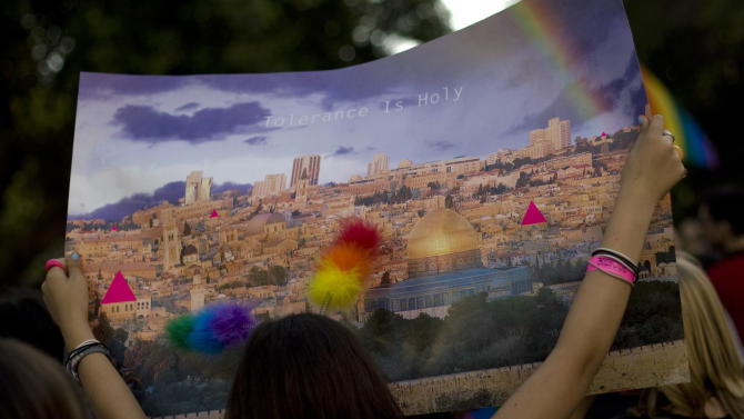 FILE - In this July 29, 2010 file photo an Israeli youth holds a picture of Jerusalem's old city during the annual gay pride parade in Jerusalem. The Conservative Jewish seminary in Israel will be ordaining gay and lesbian rabbis, overcoming years of opposition by many of its own leaders and setting up a new point of contention between the movement and Israel's Orthodox establishment. (AP Photo/Sebastian Scheiner, File)