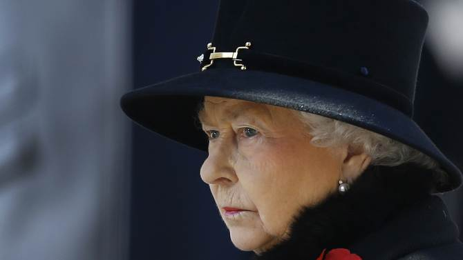 """FILE - In this Nov. 10, 2013 file photo, Britain's Queen Elizabeth II listens during the service of remembrance at the Cenotaph in Whitehall, London. For the past three decades, many Britons had hoped the rigid class system that defined their country from Dickens to """"Downton Abbey"""" was finally dying. Now they fear that class, their old bugbear, is back on the rise. From 1979, Britain was led for more than a decade by Margaret Thatcher, a grocer's daughter, and then by John Major, the son of a music-hall entertainer. The current leader, David Cameron, is a descendent of King William IV whose Cabinet is stacked with men, like him, from the country's most prestigious private schools and Oxford and Cambridge universities. (AP Photo/Kirsty Wigglesworth, File)"""