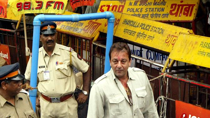 CORRECTS NUMBER OF WEAPONS FILE - In this June 19, 2007 file photo, Bollywood actor Sanjay Dutt, center, is frisked by a policeman upon his arrival at a special court trying the cases of those accused in the 1993 Mumbai bombings in Mumbai, India. India's Supreme Court has sentenced Dutt to five years in jail for illegal weapons possession in a case linked to the 1993 bombings that killed 257 people in Mumbai. The court on Thursday, March 21, 2013, ordered Dutt to surrender to police within four weeks on the charge of possessing an automatic rifle and a pistol that had been supplied to him by men subsequently convicted in the bombings. (AP Photo/Gautam Singh, File)