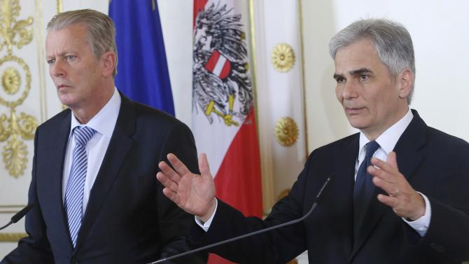 Austrian Vice Chancellor Mitterlehner and Chancellor Faymann address a news conference after a cabinet meeting in Vienna