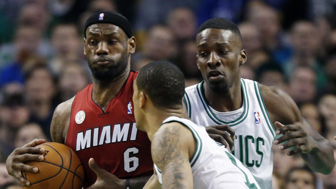 Boston Celtics' Jeff Green, right, and Courtney Lee, front, double-team Miami Heat's LeBron James (6) in the first quarter of an NBA basketball game in Boston, Monday, March 18, 2013. (AP Photo/Michael Dwyer)
