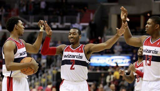 Wall, Young help Wizards beat Raptors 111-108