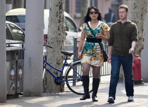 File photo of Facebook CEO Mark Zuckerberg and his girlfriend Priscilla Chan walking near Fuxing Road in Shanghai