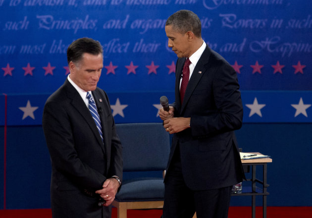 President Barack Obama and Republican presidential candidate, former Massachusetts Gov. Mitt Romney, pause as they participate in the second presidential debate, Tuesday, Oct. 16, 2012, at Hofstra Uni