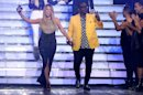 Judges Mariah Carey, left, and Randy Jackson walk on stage at the &quot;American Idol&quot; finale at the Nokia Theatre at L.A. Live on Thursday, May 16, 2013, in Los Angeles. (Photo by Matt Sayles/Invision/AP)