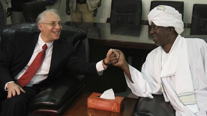 U.S. Presidential Special Envoy to Sudan and South Sudan Donald Booth greets Al-Khair al-Fahim, the head of the Sudan side in the Abyei Joint Oversight Committee (AJOC), during a meeting in Khartoum, Sudan, Saturday, Sept. 14, 2013. Booth met with Sudanese officials in Khartoum, over disputes concerning an oil-rich Abyei region claimed by the two neighbors, and he will fly on Sunday to Juba where he will hold similar meetings with South Sudan's AJOC officials. (AP Photo/Abd Raouf)