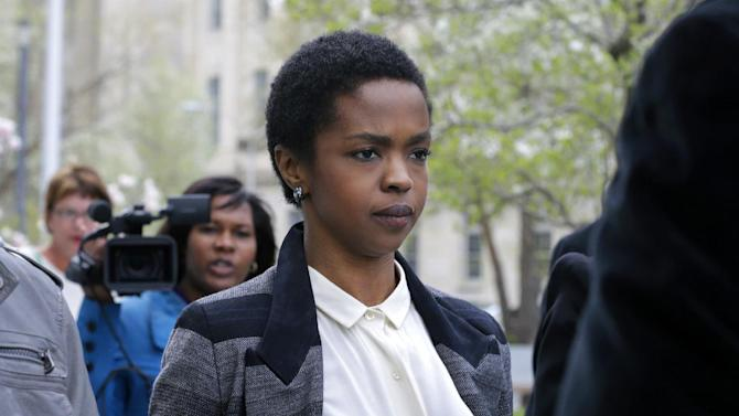 FILE - An April 22, 2013, file photo shows singer Lauryn Hill walking from federal court in Newark, N.J. Hill's attorney says she has been released from federal prison after serving time for failing to pay taxes. The singer left the facility in Connecticut on Friday, Oct. 4, 2013. (AP Photo/Mel Evans, file)