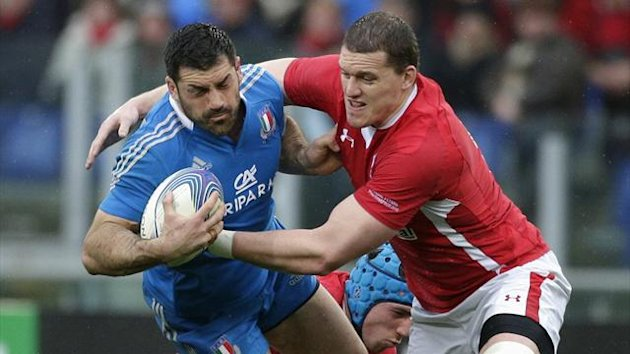 Wales' Ian Evans (R) tackles Italy's Andrea Masi during their Six Nations rugby match at the Olympic stadium in Rome (Reuters)