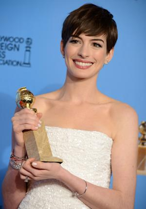 "Anne Hathaway poses with the award for best performance by an actress in a supporting role in a motion picture in ""Les Miserables"" backstage at the 70th Annual Golden Globe Awards at the Beverly Hilton Hotel on Sunday Jan. 13, 2013, in Beverly Hills, Calif. (Photo by Jordan Strauss/Invision/AP)"