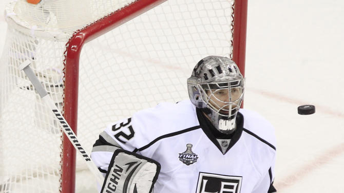 Puck shot by New Jersey Devils' Bryce Salvador flies towards Los Angeles Kings' Jonathan Quick for a goal in the second period during Game 5 of the NHL hockey Stanley Cup finals, Saturday, June 9, 2012, in Newark, N.J. (AP Photo/Frank Franklin II)