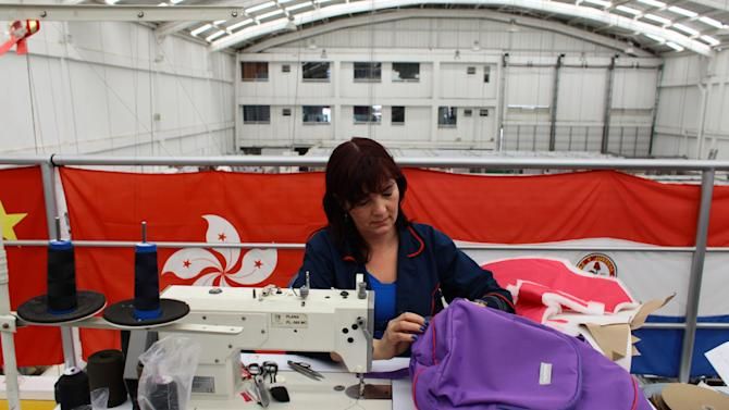 A seamstress works on an armored backpack designed for a child at the Miguel Caballero factory on the outskirts of Bogota, Colombia, Thursday, Jan. 3, 2013.  Miguel Caballero who has made armored vests for adults for more than 20 years, said he had never thought about making bulletproof goods for children. But that changed after the Dec. 14 slaying of 20 small children and six adults at the Sandy Hook Elementary in Newtown, Connecticut. His new line of products are designed for children ranging in age from 8-16 years and are priced at anywhere from $150-$600 depending on the complexity of their construction. Each piece weighs between 2-4 pounds. (AP Photo/William Fernando Martinez)