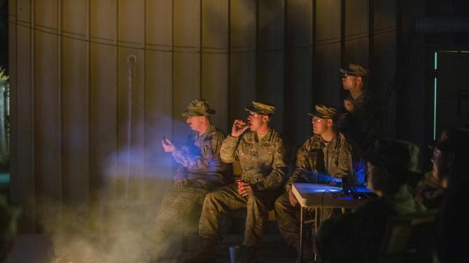 "U.S. soldiers from the 3rd Cavalry Regiment watch ""Die Hard"" projected onto an outdoor wall as part of Christmas Day celebrations on forward operating base Gamberi in the Laghman province of Afghanistan"