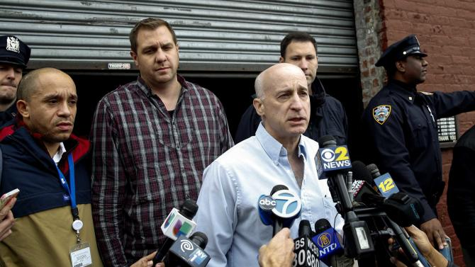 "Weiss, a doctor with the New York City Health department, speaks outside the bar and bowling venue ""The Gutter"", which was visited by Spencer, a doctor who tested positive for Ebola on Thursday, in the Brooklyn borough of New York"