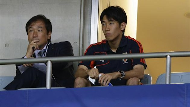 Japan's Shinji Kagawa watches from the stand during their 2014 World Cup qualification match against Iraq