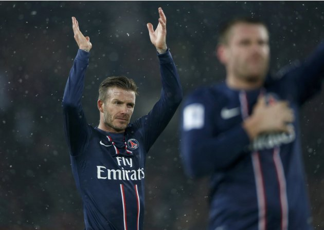 Paris Saint-Germain's Beckham applauds to the crowd after his team defeated Olympic Marseille in their French Ligue 1 soccer match at Parc des Princes stadium in Paris