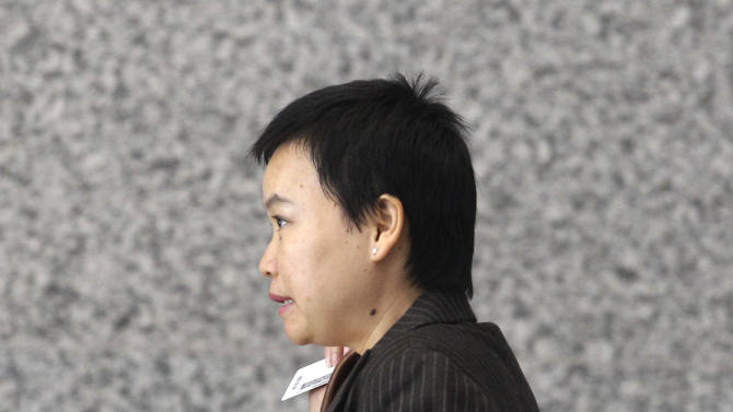 Hanjuan Jin enters the federal courthouse Wednesday, Aug. 29, 2012, in Chicago, before being sentenced to four years in prison for stealing trade secrets from Motorola. Jin, who worked as a software engineer for Motorola Inc. for nine years, was stopped during a random security search at Chicago's O'Hare International Airport on Feb. 28, 2007, before she could board a flight to China. Prosecutors say she was carrying $31,000 and hundreds of confidential Motorola documents, many stored on a laptop, four external hard drives, thumb drives and other devices.(AP Photo/M. Spencer Green)