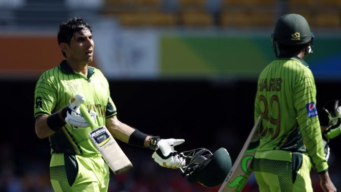 Pakistan's captain Misbah-ul-Haq reacts as he takes a break with team mate Haris Sohail during their Cricket World Cup match against Zimbabwe in Brisbane