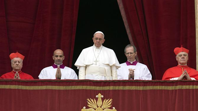 """Pope Francis delivers his """"Urbi et Orbi"""" (to the city and to the world) blessing from the central balcony of St. Peter's Basilica at the Vatican, Thursday, Dec. 25, 2014. Tens of thousands of Romans and tourists in St. Peter's Square listened as the pontiff delivered the Catholic church's traditional """"Urbi et Orbi"""" (Latin for """"to the city and to the world) Christmas message from the central balcony of St. Peter's Basilica. Francis said: """"truly there are so many tears this Christmas."""" (AP Photo/Alessandra Tarantino)"""