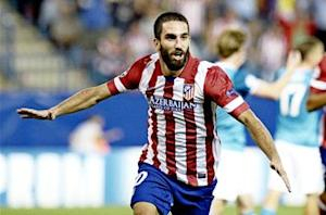Arda extends Atletico deal to 2017