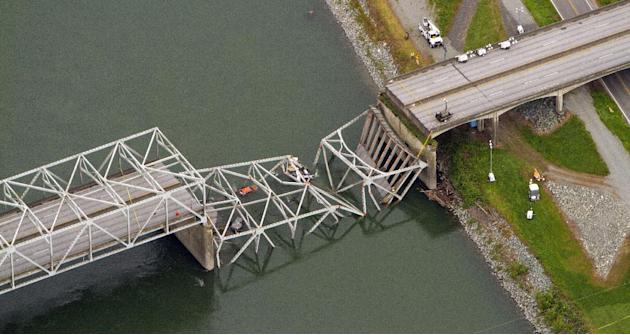 A collapsed section of the Interstate 5 bridge over the Skagit River is seen in an aerial view Friday, May 24, 2013. Part of the bridge collapsed Thursday evening, sending cars and people into the wat
