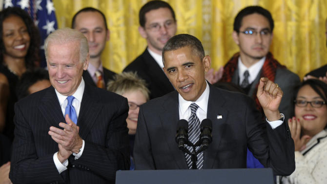 """Vice President Joe Biden applauds at left as President Barack Obama urges Congress to take back up comprehensive immigration reform during an event in the East Room of the White House in Washington, Thursday, Oct. 24, 2013. Obama said now that the partial government shutdown is over, Republicans and Democrats should be able to work together to fix what he called """"a broken immigration system."""" (AP Photo/Susan Walsh)"""