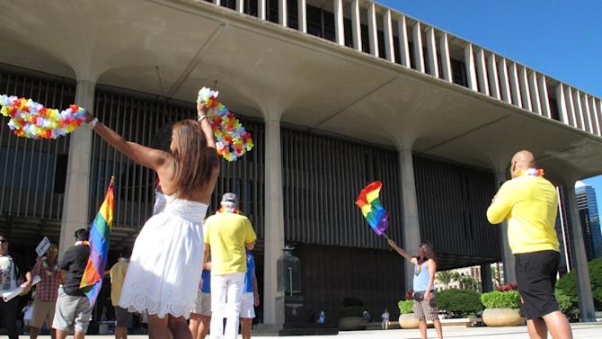 Gay marriage supporters rally outside the Hawaii Capitol in Honolulu ahead of a Senate vote on whether to legalize same-sex marriage on Tuesday, Nov. 12, 2013. (AP Photo/Oskar Garcia)