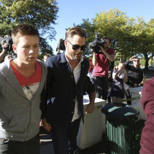 "Hollywood actor Chris Pine, center, arrives at a courthouse in Ashburton, New Zealand, Monday, March 17, 2014. Pine, known for playing Captain Kirk in the ""Star Trek"" movies, pleaded guilty in the New Zealand court to drunken-driving charges. The 33-year-old was fined $93 New Zealand dollars ($79) and had his New Zealand driver's license suspended for six months during a hearing at the Ashburton District Court. (AP Photo/Ashburton Guardian, Tetsuro Mitomo) NEW ZEALAND OUT, AUSTRALIA OUT, NO SALES"