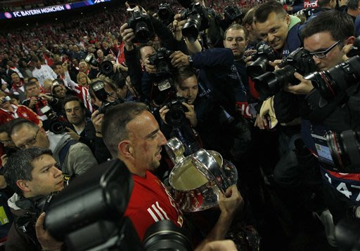 Bayern's Franck Ribery of France, second left, holds the trophy, after winning the Champions League Final against Borussia Dortmund,  at Wembley Stadium in London, Saturday May 25, 2013