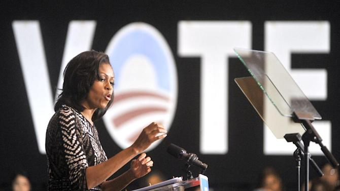 First lady Michelle Obama speaks to Friday, October 19, 2012, during a campaign event in Racine, Wis. About 2,500 people gathered to see her speak at Memorial Hall. (AP Photo/Journal Times, Gregory Shaver)