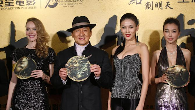 """From left, French actress Laure Weissbecker, Hong Kong movie star Jackie Chan, Chinese actresses Zhang Lanxin and Yao Xingtong pose for photographers during the charity premiere of his new movie """"CZ12"""" in Hong Kong, Thursday Dec. 13, 2012. Jackie Chan suggests in a recent interview that protests should be restricted in the freewheeling Chinese city of Hong Kong. The action star lamented that Hong Kong has become a city of protest, where people """"scold China, scold the leaders, scold anything, protest against anything."""" (AP Photo/Kin Cheung)"""