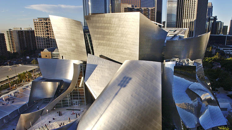 This Oct. 20, 2003 file photo shows early morning sun illuminating the new Walt Disney Concert Hall in downtown Los Angeles. Downtown has undergone a revival in recent years, adding upscale condos, chichi bars and the iconic, Frank Gehry-designed Walt Disney Concert Hall.  (AP Photo/Nick Ut, file)