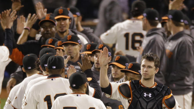 San Francisco Giants catcher Buster Posey, right, high-fives pitcher Sergio Romo (54) after Game 6 of baseball's National League championship series against the St. Louis Cardinals Sunday, Oct. 21, 2012, in San Francisco. The Giants won 6-1 to tie the series at 3-3. (AP Photo/Mark Humphrey)