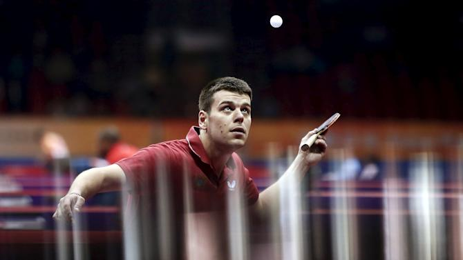 Luka Bakic of Montenegro eyes the ball as he serves to Timothy Wang of the U.S. during the qualification round match at the World Table Tennis Championships in Suzhou