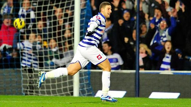 Queens Park Rangers' Moroccan midfielder Adel Taarabt celebrates scoring during the English Premier League football match between Queens Park Rangers and Fulham at Loftus Road