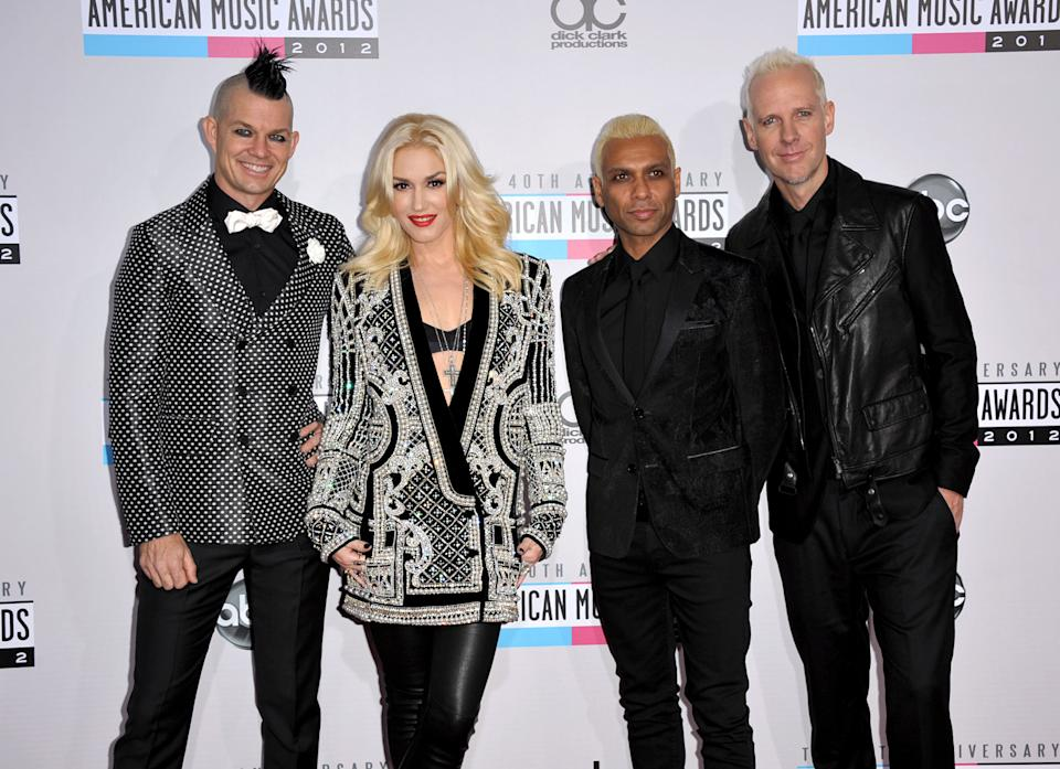 Musical group No Doubt, from left, Adrian Young, Gwen Stefani, Tony Kanal and Tom Dumont arrive at the 40th Anniversary American Music Awards on Sunday, Nov. 18, 2012, in Los Angeles. (Photo by Jordan Strauss/Invision/AP)