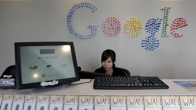 An employee sits behind a reception desk during a media tour in the Google data centre in Changhua Coastal Industrial Park