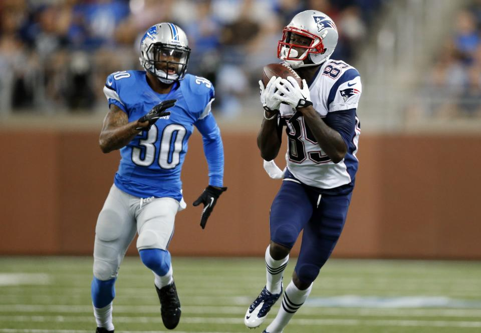 New England Patriots wide receiver Kenbrell Thompkins (85) catches a pass for a 37-yard gain as Detroit Lions defensive back Darius Slay (30) defends in the first quarter of an NFL preseason football game in Detroit, Thursday, Aug. 22, 2013. (AP Photo/Rick Osentoski)