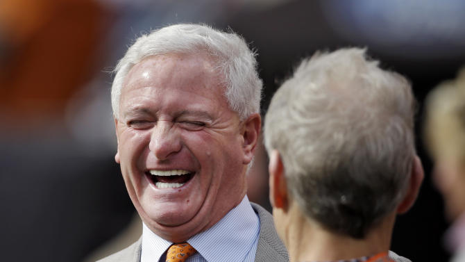 Cleveland Browns owner-in-waiting Jimmy Haslam laughs on the sidelines before an NFL football game against the Cincinnati Bengals Sunday, Oct. 14, 2012, in Cleveland. Haslam, who purchased majority ownership of the team from Randy Lerner, is expected to be approved as the Browns new owner by the NFL Oct. 16. (AP Photo/Mark Duncan)